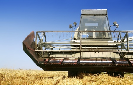 agriculturist: Agriculture - combine on field in hot summer