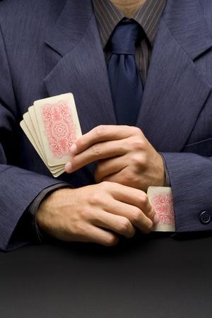 unfair: Unfair businessman - metaphor with card player