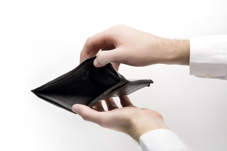Black hole in wallet - be penniless - empty wallet hold in hands photo