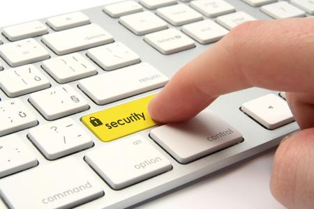 teclado: Teclado con bot�n de seguridad - el concepto de seguridad inform�tica Foto de archivo