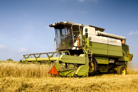 combine harvester: Agriculture - Combine (harvester) on the field Editorial