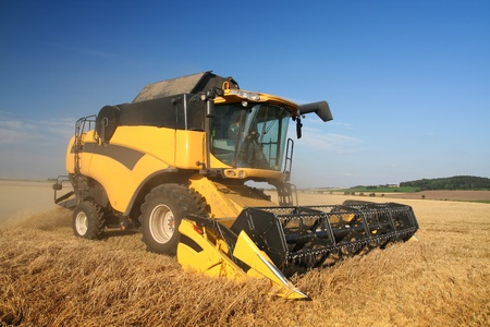 haymaking: Agriculture - Combine (harvester) on the field Editorial