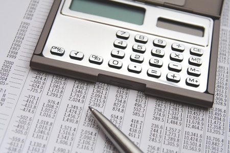 economist: Economist in action - economic sheet, calculator and pen