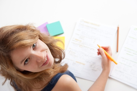 boffin: College student studying (swot up) for exam. Focused on face. Top view.