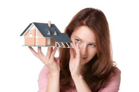 realty residence: Woman (estate agency client or architect) browse new house represented by model