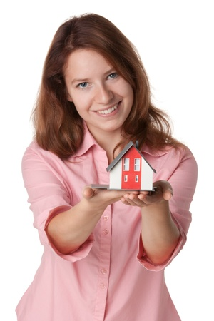 tout: House agent offer (tout) new building represented by model Stock Photo