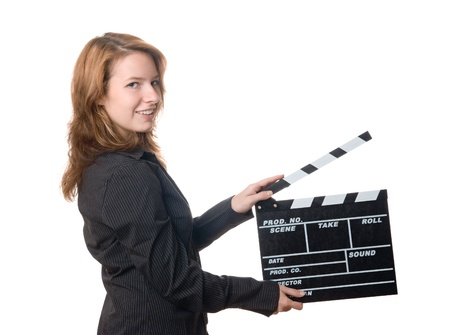 film shooting: Young woman holding film slate