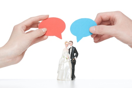 pronounce: Say yes - wedding figurines  bride and groom  with cartoon bubble hold i hand by real woman and man