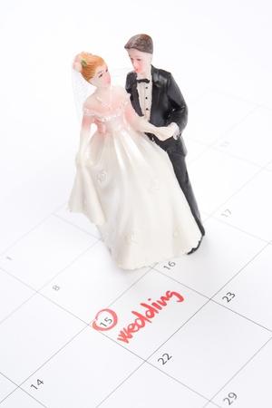 planificación familiar: Palabra de la boda en el calendario y los figurines de la boda - la planificación de un concepto de la boda Foto de archivo