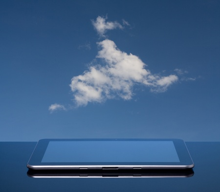 Cloud computing concept  Tablet computer and cloud  photo