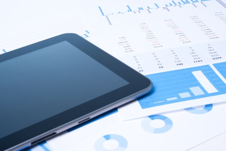data sheet: Modern business analysis with digital tablet computer, sheet and graphs