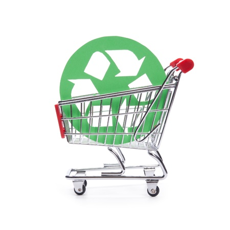 consumerism: Socially responsible consumerism - buy recycled  environment-friendly  products concept  Shopping cart  shopping trolley  with green recycled symbol