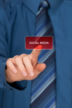 Social media concept  Mans hand click on social media button ahead  Selective focused hand  photo
