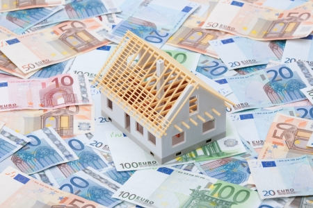 Building cost  construction cost  concept  Model of house under construction  rough construction  and money   photo