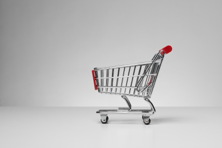 shopping cart: Empty shopping cart on gray background  Side view