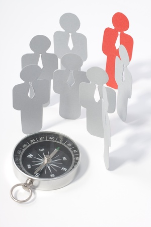 exceptional: Looking for exceptional employee (represented by paper figures). Headhunters equipment - compass.