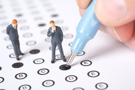 testing: Student complete the questionnaire - school exam concept.
