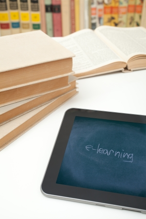 E-learning concept  Digital tablet in study room with image of chalk board on touch screen with handwritten text e-learning  Stock Photo - 16157275
