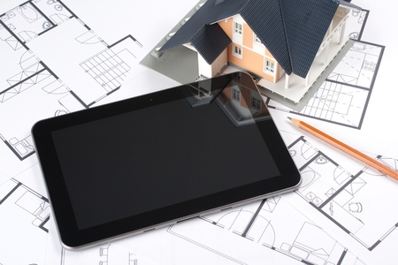 Model of the house on blueprints, digital tablet and pencil  Architect Stock Photo - 16157124