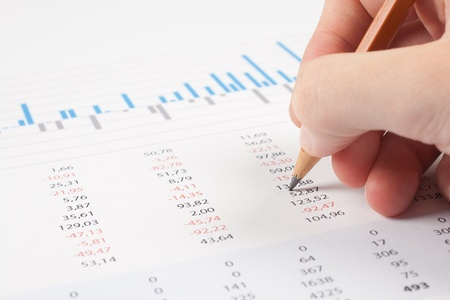 spreadsheets: Concept of business report analysis - hand with pencil, digital tablet, graph and sheet  You may place your own screen, for example web page on tablet screen  Stock Photo