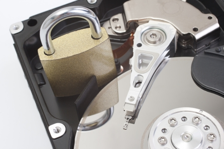 Studio shot of hard disk  hard drive, hard disk drive  and padlock   photo