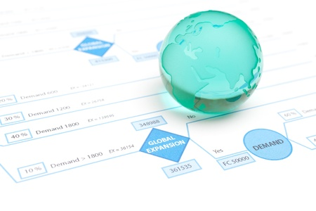 decision making: Global expansion decision tree and globe made from glass.