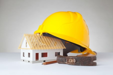 Builder equipment and model of the house - rough construction.  photo