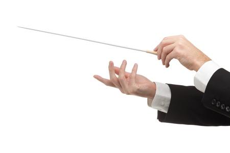 musica clasica: Hombre manos de orquesta, una con bastón. Fondo blanco. Foto de archivo