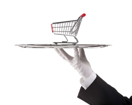 serving tray: Consumerism concept - waiter is having model of the shopping cart on tray.