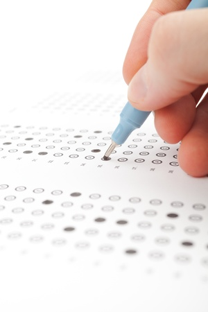 Student complete the questionnaire  filling the test form  - school exam concept and another test completing  new job interview, IQ test etc     photo