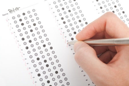 admission: Teacher correct the test  questionnaire   Top view  Stock Photo