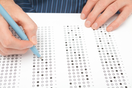 exams: Student complete the questionnaire  filling the test form  - school exam concept and another test completing  new job interview, IQ test etc