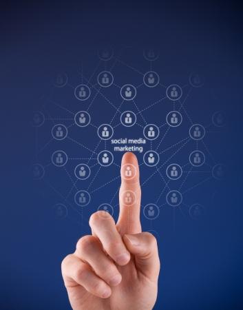 Social media marketing concept - man click on text social media marketing and network of people relationships. photo