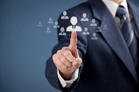 crm: Human resources officer choose employee standing out of the crowd   Stock Photo