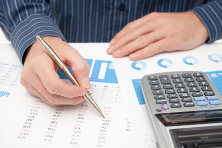 Business analysis - calculator, sheet, graph,  business report  and analyst