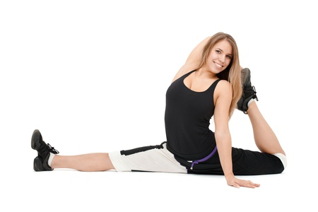 stretchy: Stretchy woman dancer against white background. Stock Photo