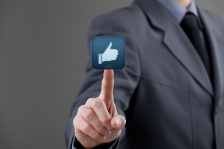 Social media concept  Businessman click on the like button Stock Photo - 18855618