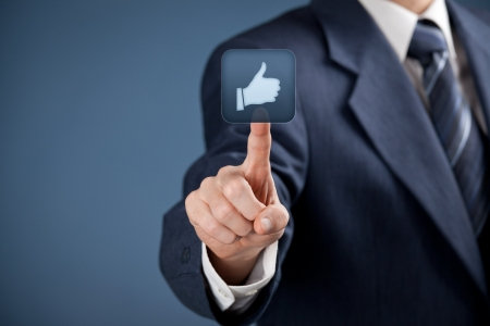 Social media concept  Businessman click on the like button   photo