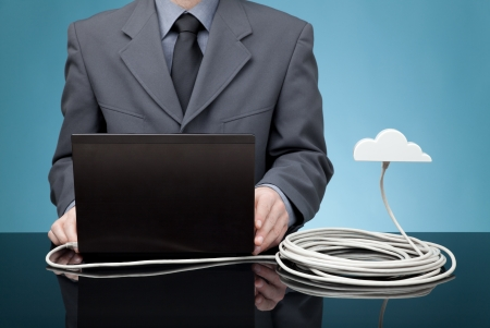 ethernet: Cloud computing concept  Man send data from laptop to cloud via ethernet cable