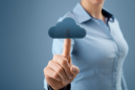 cloud technology: Cloud computing concept  Woman click on cloud icon ahead  Selective focused on finger and cloud  Stock Photo