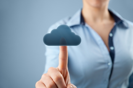 selective: Cloud computing concept  Woman click on cloud icon ahead  Selective focused on finger and cloud   Stock Photo