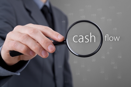 Cash Flow: Focus on cash flow and audit of accounts concept. Businessman (auditor) analyze cash flow. Positive numbers fly up, negative numbers fly down.