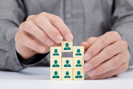 Human resources and social networking concept - recruiter complete team by one person  employee  represented by icon   photo