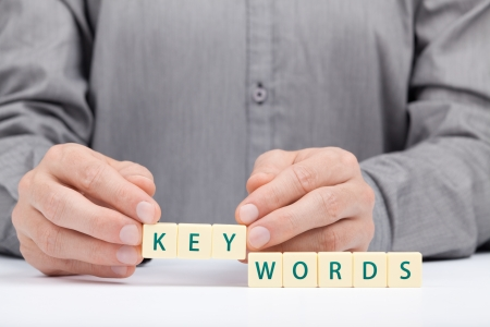 keyword: Keywords concept  Man complete word keywords   Stock Photo