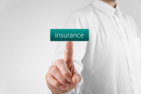 unworried: Man click on virtual button with text insurance.  Stock Photo