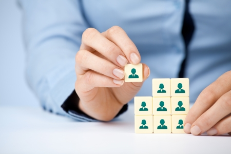 headhunter: Human resources, social networking and assessment center concept - recruiter complete team by one person (employee) represented by icon.