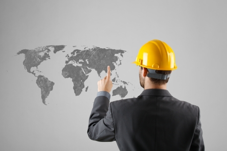 relocation: Offshoring and outsourcing concept - relocation of manufacturing processes to a lower-cost destination.