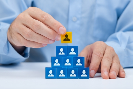 headhunter: Human resources and corporate hierarchy concept - recruiter complete team by one leader person  CEO  represented by gold cube and icon   Stock Photo