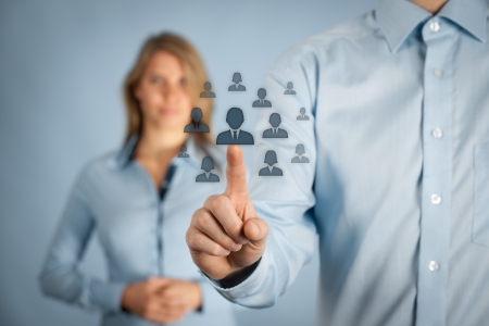 idioms: Human resources and CRM concept - officer and supervisor looking for employee represented by icon. Stock Photo