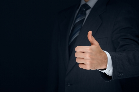 favourable: Nonverbal communication. Like, OK, perfect, good job, praise, satisfied, thumb up gesture of businessman.